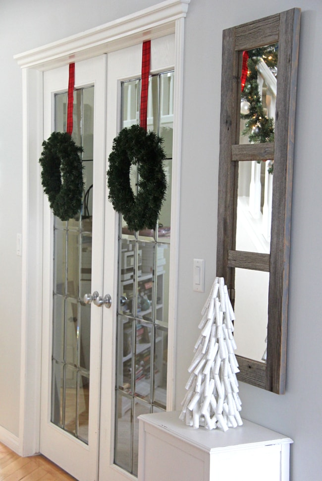 Love the wreaths hung indoors!