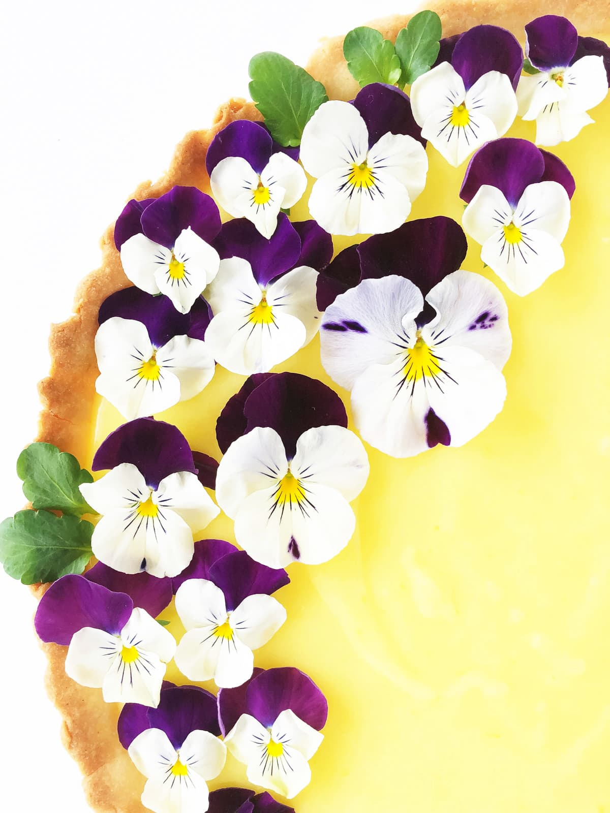Lemon Tart with a Shortbread Cookie Crust, garnished with Pansies
