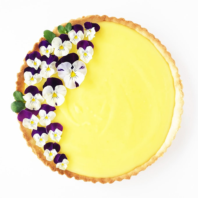 Lemon Tart with a Shortbread Cookie Crust, and garnished with edible Pansies