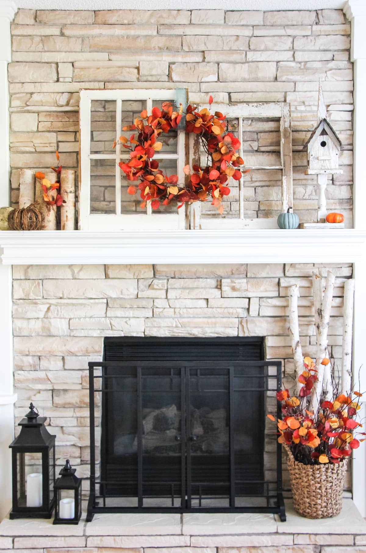 Love the fire-y wreath on this fall mantel!